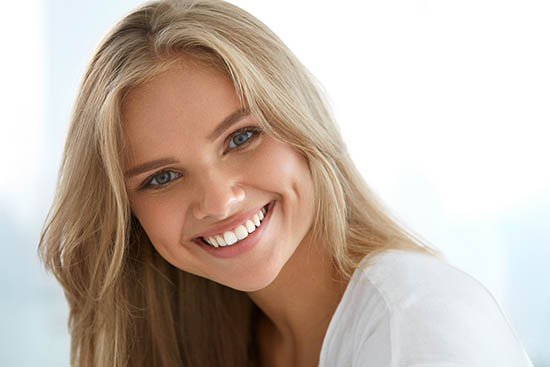 Beauty Woman Portrait. Girl With Beautiful Face Smiling